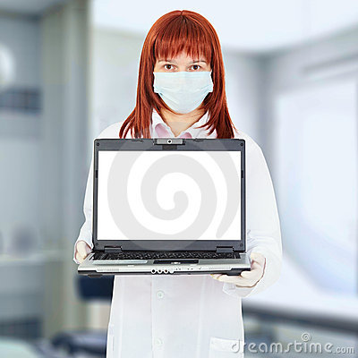 Nurse with computer in hospital