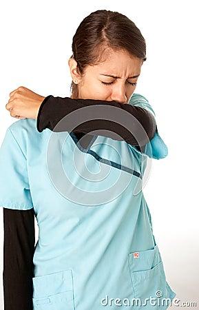 Nurse Coughing into Elbow