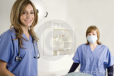 Nurse and doctor in hospital room