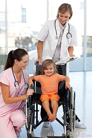 Nurse and doctor with a young patient