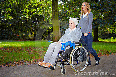 Nurse driving elderly woman