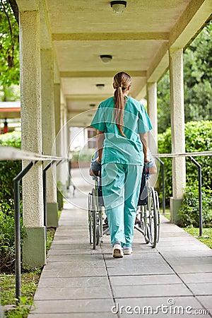 Nurse driving wheelchair
