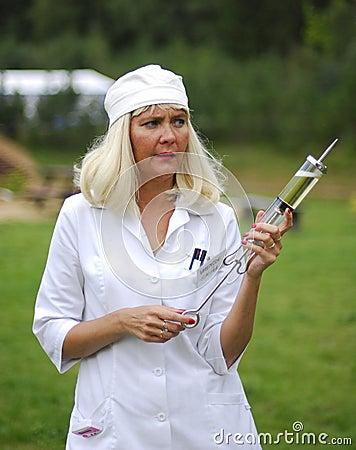 Nurse with a gigantic syringe