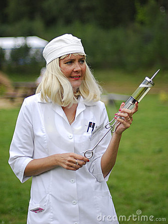 Nurse with a gigantic syringe