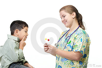 Nurse gives boy a choice of candy.