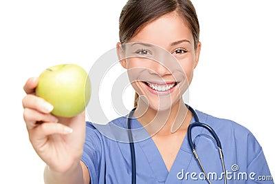 Nurse giving apple