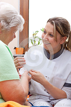 Nurse handed patient an letter