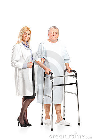 Nurse helping a patient to use a walker