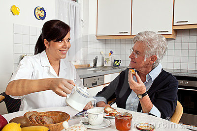 Nurse helping senior at