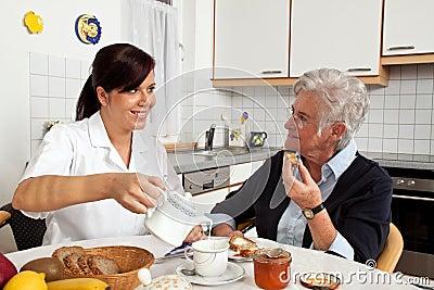 Nurse helping senior at