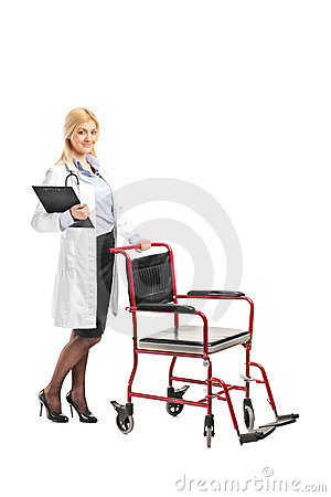 Nurse holding a clipboard next to a wheelchair