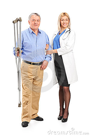 Nurse holding a senior patient with crutches