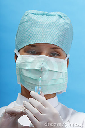 Nurse holding a syringe