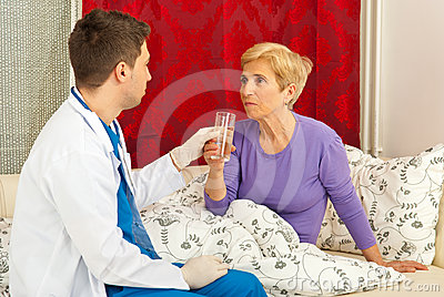 Nurse man give water to senior
