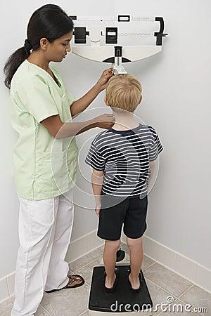 Nurse Measuring Boy s Height