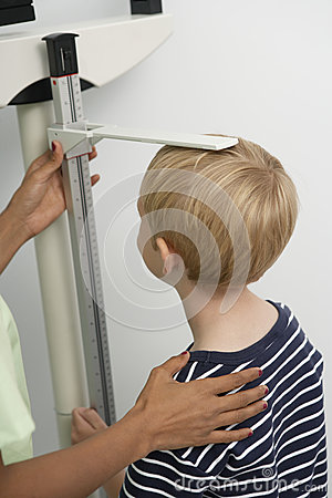 Nurse Measuring Boy s Height