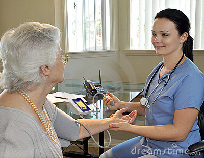 Nurse measuring the patient s blood pressure