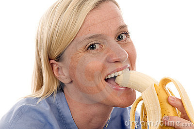 Nurse medical person eating banana