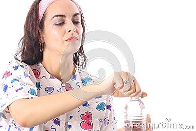 Nurse opening bottled water