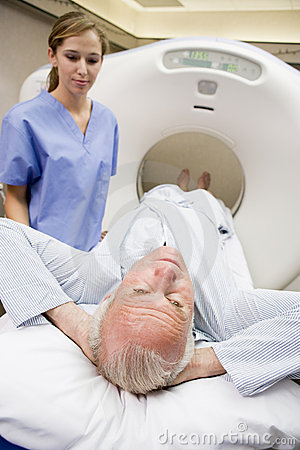 Nurse With Patient Having CAT Scan