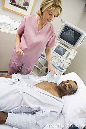 Nurse With Patient Having Ultrasound Scan