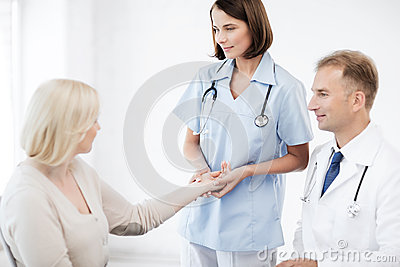 Nurse with patient measuring pulse