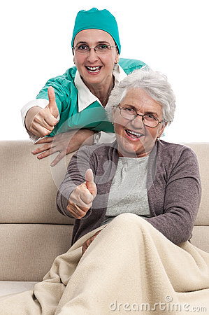 Nurse and patient thumb up