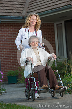 Nurse Push Senior on Wheelchair Outdoor