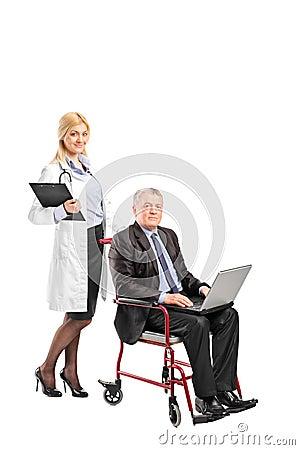 Nurse pushing a businessman in wheelchair