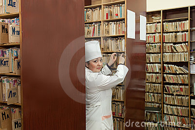 Nurse searching  medical chart
