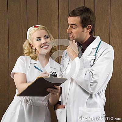 Nurse smiling at doctor.