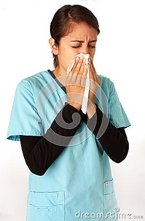 Nurse Sneezing into Tissue