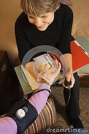 Free Nurse Taking Blood Pressure Of Elderly Woman. Royalty Free Stock Photo - 2037455