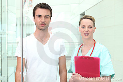 Nurse watching young patient