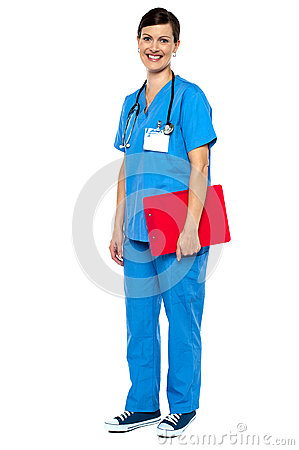 Nurse wearing blue uniform  holding red clipboard