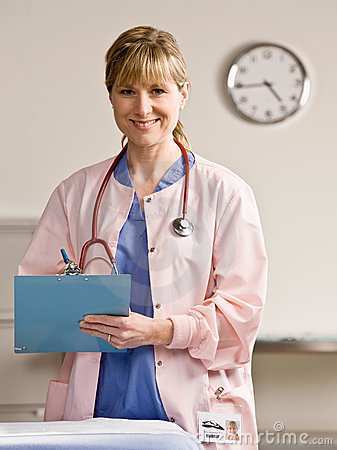Free Nurse With Stethoscope And Medical Chart Stock Photography - 6581532