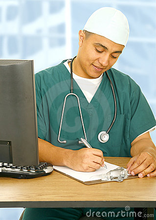 Nurse Writing On Clip Board