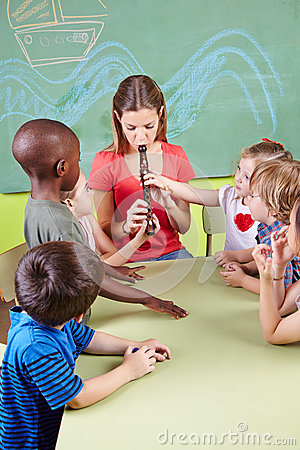 Nursery teacher playing flute