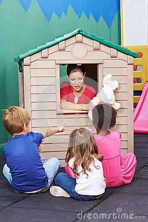 Free Nursery Teacher Using Playhouse For Theater Play Royalty Free Stock Image - 52053696