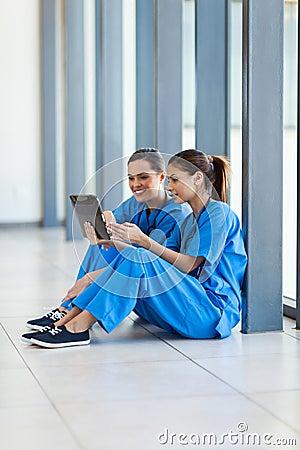 Nurses using tablet computer