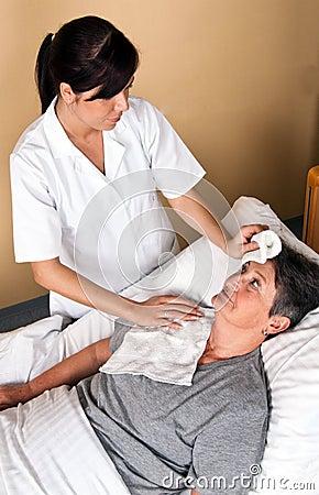 Nurses wash a patient