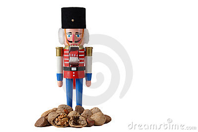 Nutcracker soldier with pile of nuts