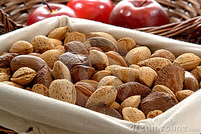 Nuts with Almonds and Hazelnuts in a Wicker Basket