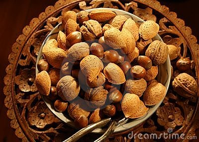 Nuts on carved wood table