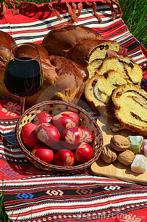 Nuts filling pound cake and red eggs for Easter