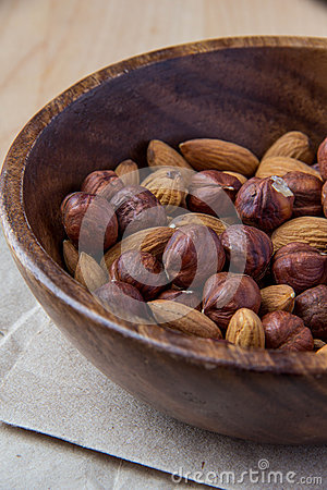Nuts in wooden bowl