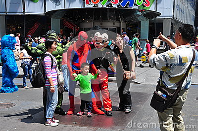 NYC: Asian Tourists Posing with Comic Book Characters Editorial Stock Image