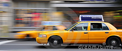Nyc cab driving through traffic Editorial Image