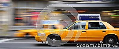 Nyc cab driving through traffic Editorial Image