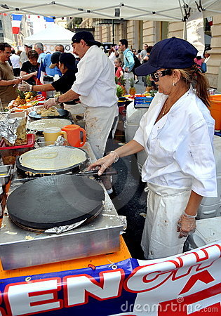 NYC: Chefs making Crêpes at Festival Editorial Photo
